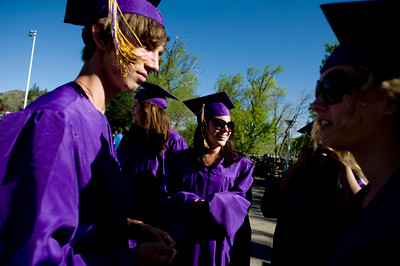 (Left to right) Matt Cantor, 18, Allison Caldera, 17, Shayne Campbell, 18, and Stephanie Ryne, 17, wait for the commencement ceremony to begin at Boulder High School, Saturday, May 22, 2010.   Kasia Broussalian  For a video of the graduation ceremony, please visit www.dailycamera.com