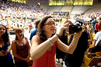 Anne Tengler looks for her son Riley to enter the floor during the beginning of the Monarch High School Commencement at the Coors Events Center on the CU Boulder Campus on Saturday May 22, 2010. For more photos and a video of the graduation go to www.dailycamera.com Photo by Paul Aiken / The Camara /
