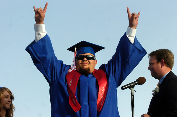 """Gregory Garcia acknowledges the crowd before getting his diploma during the Centaurus High School Commencement at the school in Lafayette on Saturday May 22, 2010.<br /> For more photos and a video of the graduation go to  <a href=""""http://www.dailycamera.com"""">http://www.dailycamera.com</a><br /> Photo by Paul Aiken / The Camara /"""