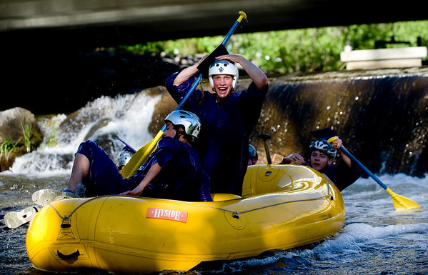 "Gordon Bowman, 18, checks to make sure his cap is still in place after falling over the damn at Broadway on the Boulder Creek as they raft to their graduation ceremony at Boulder High School, Saturday, May 22, 2010. <br /> <br /> Kasia Broussalian<br /> <br /> For a video of the graduation ceremony, please visit  <a href=""http://www.dailycamera.com"">http://www.dailycamera.com</a>"