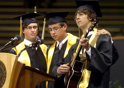 From left to right Jeff Stephens, Jordan Cohen and Sam Ackerman sign a farewell song to the students and school during the Monarch High School Commencement at the Coors Events Center on the CU Boulder Campus on Saturday May 22, 2010. For more photos and a video of the graduation go to www.dailycamera.com Photo by Paul Aiken / The Camara /