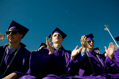 (From left to right) Dave Sherrier, 17, Brendan Rice, 18, and Matt McCurdy, 18, clap during the commencement ceremony at Boulder High School, Saturday, May 22, 2010.   Kasia Broussalian  For a video of the graduation ceremony, please visit www.dailycamera.com