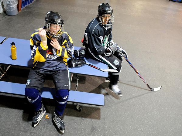 """Will Graber, 14, of Longmont, left, and Mike Leslie, 14, of Lafayette, share a laugh while taking a break during a """"Stick and Puck"""" open ice session at Boulder Valley Ice at Superior on Sunday, April 3, in Superior. For more photos and video go to  <a href=""""http://www.dailycamera.com"""">http://www.dailycamera.com</a><br /> Jeremy Papasso/ Camera"""