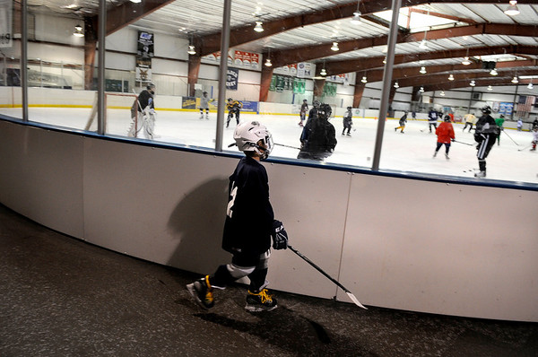 "Logan Akerson, 8, heads for the ice-rink during a ""Stick and Puck"" open ice session at Boulder Valley Ice at Superior on Sunday, April 3, in Superior. For more photos and video go to  <a href=""http://www.dailycamera.com"">http://www.dailycamera.com</a><br /> Jeremy Papasso/ Camera"