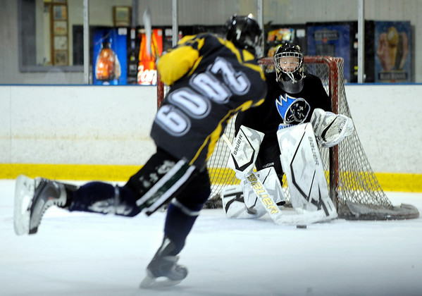 """Will Graber, 14, takes a shot on Goalkeeper Philip Gronstedt, 16, during a """"Stick and Puck"""" open ice session at Boulder Valley Ice at Superior on Sunday, April 3, in Superior. For more photos and video go to  <a href=""""http://www.dailycamera.com"""">http://www.dailycamera.com</a><br /> Jeremy Papasso/ Camera"""