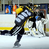 "Will Graber, 14, takes a shot on Goalkeeper Philip Gronstedt, 16, during a ""Stick and Puck"" open ice session at Boulder Valley Ice at Superior on Sunday, April 3, in Superior. For more photos and video go to  <a href=""http://www.dailycamera.com"">http://www.dailycamera.com</a><br /> Jeremy Papasso/ Camera"