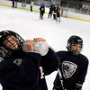 "Adam Wuth, 7, of Westminster, left, and Ayden Skaggs, 6, of Brighton, take a break during a ""Stick and Puck"" open ice session at Boulder Valley Ice at Superior on Sunday, April 3, in Superior. For more photos and video go to  <a href=""http://www.dailycamera.com"">http://www.dailycamera.com</a><br /> Jeremy Papasso/ Camera"