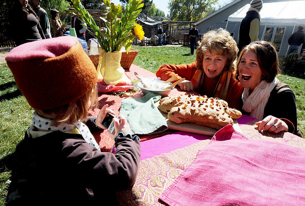 Madrona Robinson, 4, photographs her grandmother Teri Fischer, left, and her mother Merret Mann at the festival.<br /> The Boulder Waldorf Kindergarten held its Michaelmas Harvest Festival at the school on Friday.<br /> Cliff Grassmick / October 2, 2009