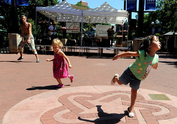 "Camille Placer, 4, right, dances with her new friend Sofia Box, 3, to the music of the Matt Clark Band on Friday.<br /> The BoulderFest, Downtown Boulder's newest festival, will bring together the best local bands, brews, wines, and food on the Pearl Street  Friday and Saturday.<br /> For more photos and a video, go to  <a href=""http://www.dailycamera.com"">http://www.dailycamera.com</a>.<br /> Cliff Grassmick / August 21, 2009"