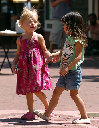 "Sofia Box, 3, left, and Camille Placer, 4,  have a few kind words after dancing.<br /> The BoulderFest, Downtown Boulder's newest festival, will bring together the best local bands, brews, wines, and food on the Pearl Street  Friday and Saturday.<br /> For  more photos and a video, go to  <a href=""http://www.dailycamera.com"">http://www.dailycamera.com</a>.<br /> Cliff Grassmick / August 21, 2009"
