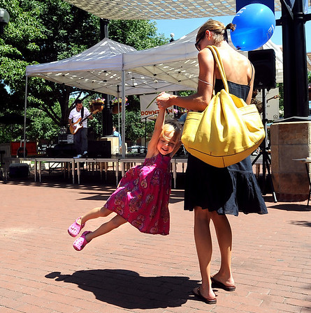 "Nicole Box swings her daughter Sofia, 3, to the music of the Matt Clark Band.<br /> The BoulderFest, Downtown Boulder's newest festival, will bring together the best local bands, brews, wines, and food on the Pearl Street  Friday and Saturday.<br /> For more photos and a video, go to  <a href=""http://www.dailycamera.com"">http://www.dailycamera.com</a>.<br /> Cliff Grassmick / August 21, 2009"
