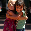 "Sofia Box, 3, left, and Camille Placer, 4,  have a for each other after dancing.<br /> The BoulderFest, Downtown Boulder's newest festival, will bring together the best local bands, brews, wines, and food on the Pearl Street  Friday and Saturday.<br /> For  more photos and a video, go to  <a href=""http://www.dailycamera.com"">http://www.dailycamera.com</a>.<br /> Cliff Grassmick / August 21, 2009"