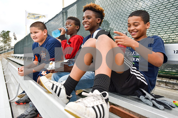11-year-olds Gilbert Peña, Jeremijah Washington, Derrick McFall and Colton Miller watch baseball during a Boys 2 Men mentoring event at Mike Carter Field in Tyler, Texas, on Monday, March 6, 2017. Boys 2 Men Leadership Club is a mentorship program for boys in 4th and 5th grade at Bell Elementary School. (Chelsea Purgahn/Tyler Morning Telegraph)