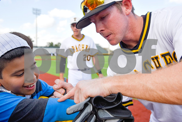 Tyler Junior College baseball player Colton Whitehouse  signs Kevin Gonzalez's, 10, shirt during a Boys 2 Men mentoring event at Mike Carter Field in Tyler, Texas, on Monday, March 6, 2017. Boys 2 Men Leadership Club is a mentorship program for boys in 4th and 5th grade at Bell Elementary School. (Chelsea Purgahn/Tyler Morning Telegraph)