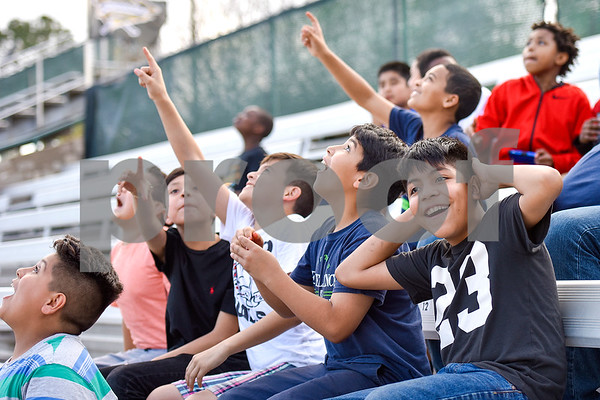 Peter Adrade, 11, far right, and others react to a foul ball in the air during a Boys 2 Men mentoring event at Mike Carter Field in Tyler, Texas, on Monday, March 6, 2017. Boys 2 Men Leadership Club is a mentorship program for boys in 4th and 5th grade at Bell Elementary School. (Chelsea Purgahn/Tyler Morning Telegraph)