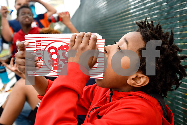 Kendrick Ford, 10, eats popcorn during a Boys 2 Men mentoring event at Mike Carter Field in Tyler, Texas, on Monday, March 6, 2017. Boys 2 Men Leadership Club is a mentorship program for boys in 4th and 5th grade at Bell Elementary School. (Chelsea Purgahn/Tyler Morning Telegraph)