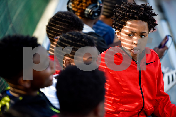 Kendrick Ford, 10, talks with friends during a Boys 2 Men mentoring event at Mike Carter Field in Tyler, Texas, on Monday, March 6, 2017. Boys 2 Men Leadership Club is a mentorship program for boys in 4th and 5th grade at Bell Elementary School. (Chelsea Purgahn/Tyler Morning Telegraph)