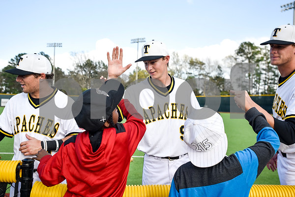 Tyler Junior College baseball players greet boys during a Boys 2 Men mentoring event at Mike Carter Field in Tyler, Texas, on Monday, March 6, 2017. Boys 2 Men Leadership Club is a mentorship program for boys in 4th and 5th grade at Bell Elementary School. (Chelsea Purgahn/Tyler Morning Telegraph)