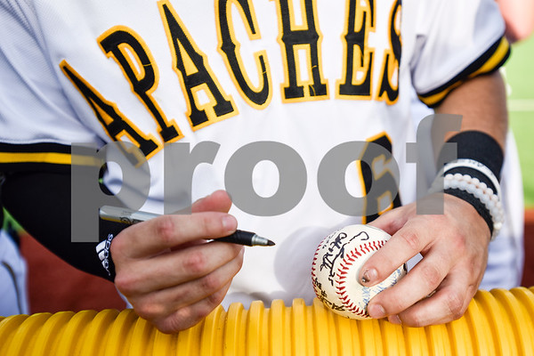 Tyler Junior College baseball player Justin Roach signs a boy's baseball during a Boys 2 Men mentoring event at Mike Carter Field in Tyler, Texas, on Monday, March 6, 2017. Boys 2 Men Leadership Club is a mentorship program for boys in 4th and 5th grade at Bell Elementary School. (Chelsea Purgahn/Tyler Morning Telegraph)