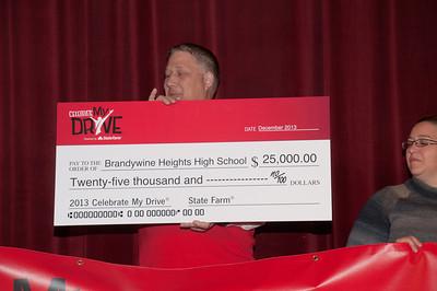 Patriot photos by Scott Weldon State Farm agent Steve Drasher of Kutztown, presents a $25,000 check to Brandywine Heights High School.