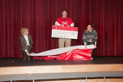 Patriot photos by Scott Weldon State Farm agent Steve Drasher of Kutztown, presents a $25,000 check to Brandywine Heights High School.