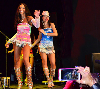 Women takes a cell phone picture of the dancers on stage