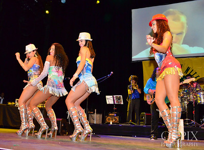 Group of dancers performing on stage at Club Nokia - Brazilian Carnaval