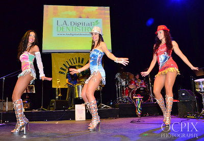Three dancers entertain the crowds at Club Nokia Brazilian Carnaval