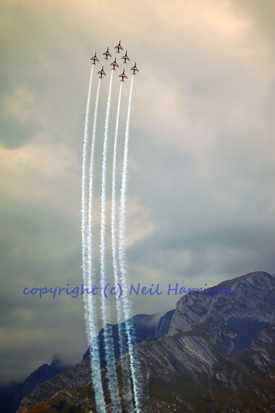 SION, SWITZERLAND - SEPTEMBER 17: Patrouille de France high in the sky at the Breitling Air show.  September 17, 2011 in Sion, Switzerland