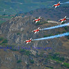 SION, SWITZERLAND - SEPTEMBER 17: Swiss airforce team flying in formation at the Breitling Air show.  September 17, 2011 in Sion, Switzerland