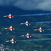 SION, SWITZERLAND - SEPTEMBER 18: Swiss airforce team in formation over the alps at the Breitling Air show.  September 18, 2011 in Sion, Switzerland