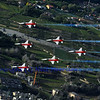 SION, SWITZERLAND - SEPTEMBER 18: Swiss airforce team flies low over Sion at the Breitling Air show.  September 18, 2011 in Sion, Switzerland