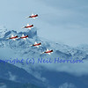 SION, SWITZERLAND - SEPTEMBER 18: Patrouille Suisse in the alps at the Breitling Air show.  September 18, 2011 in Sion, Switzerland