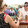 Woodstock Inn Beer Rep. Adam Marks serves up so of their beer at the annual Nashua River Brewers Festival on Saturday at Riverfront Park Fitchburg. SENTINEIL & ENTERPRISE/JOHN LOVE
