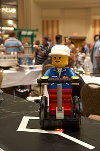 LEGO Segway. Notice the light sensor on the bottom that helps it stay on the white tape.