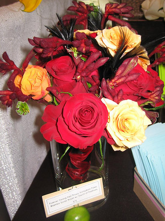 forever red roses, kangaroo paws, mambo spray roses & black feathers