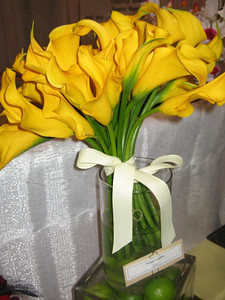 simple bouquet of canary yellow callas with simple ivory grosgrain bow