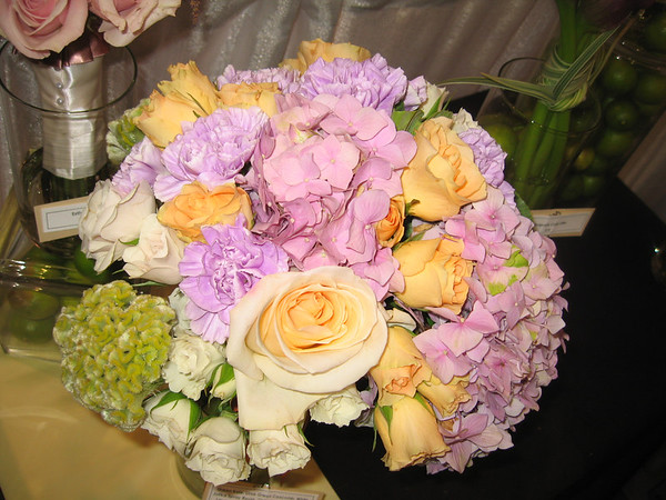 lavender hydrangeas, lime green coxcombs, lavender carnations, ivory spray roses with peach spray roses