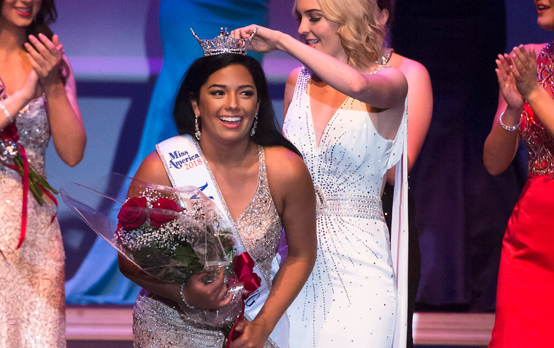 Justin Sheely | The Sheridan Press<br /> Sheridan's Becky Bridger, left, receives the Miss Wyoming 2018 crown by Miss Wyoming 2017 Cheyenne Buyert at the WYO Performing Arts and Education Center Saturday, June 23, 2018.