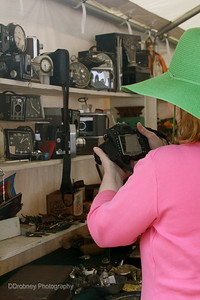 My friend, and fellow photog, Laura - admiring this great booth with lots of antique cameras and clocks!  Such fun at Brimfield!  ;-)
