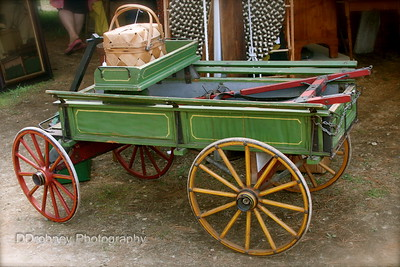 If I had an extra $1500, I would have bought this in a minute.  It's an antique photographer's wagon...how cool would that be as a prop?!?