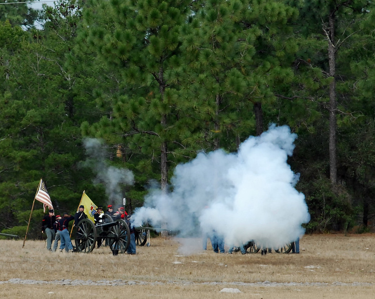 Union cannon fire on Rebel positions.