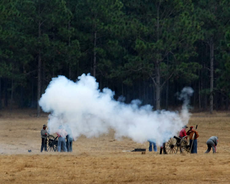 Confederate cannon fire on Union positions.