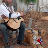 A southern guitar player with his dog Dixie.