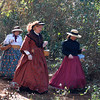 "The ladies of the camp go through the woods to attend a ""Ladies Tea"""