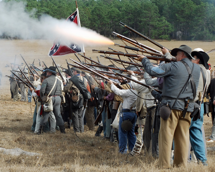 The Confederate riflemen answer with a volley.
