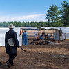 A banjo player strolls to camp before the battle begins.