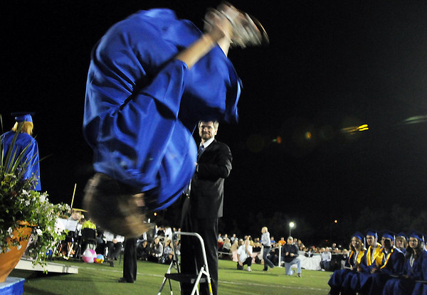 Gymnast JoJo Hayden does a back flip off of the stage after receiving her diploma at Saturday's  Broomfield High graduation at Elizabeth Kennedy Stadium.<br /> May 22, 2010<br /> Staff photo/ David R. Jennings