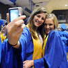 Rachel Sier, left, and Katie Connelly takes a picture before the Broomfield High graduation at Elizabeth Kennedy Stadium on Saturday.<br /> May 22, 2010<br /> Staff photo/ David R. Jennings