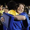 Tara Lundquist hugs Darius Nazemi after Saturday night's Broomfield High graduation at Elizabeth Kennedy Stadium.<br /> May 22, 2010<br /> Staff photo/ David R. Jennings